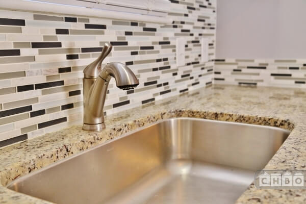 Granite with tiled backsplash