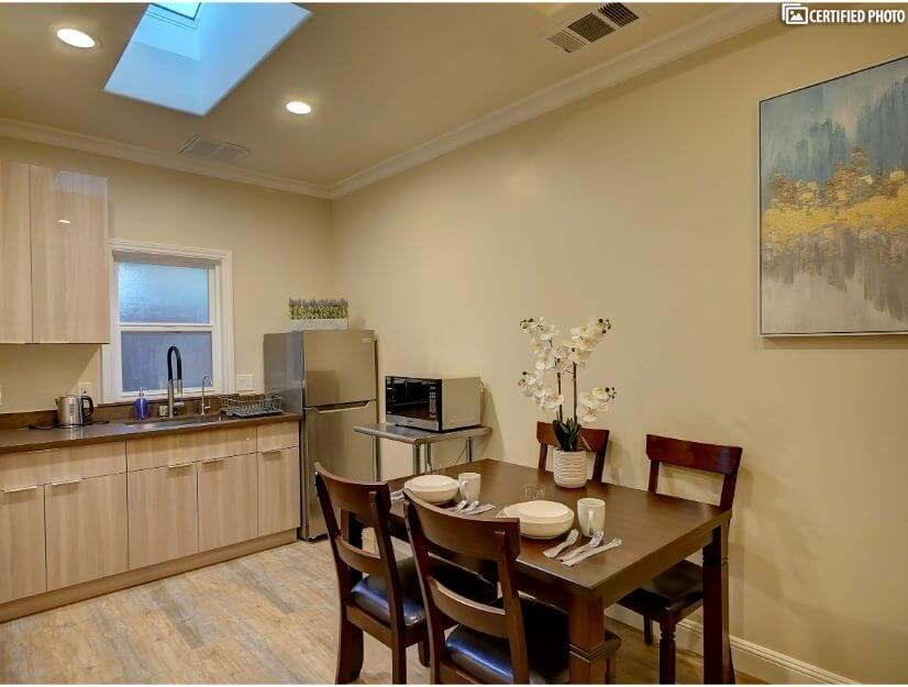 Suite D - Dining & fully functional kitchenette w/ wet bar.