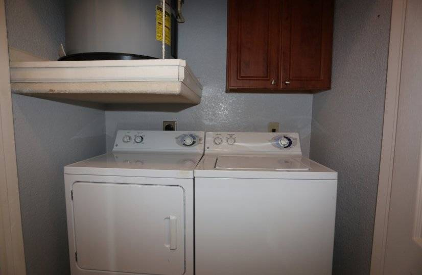 washer and dryer in unit, plus individual water heaters