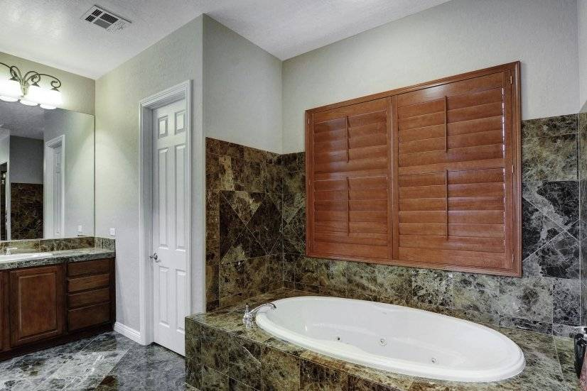 Master bathroom jetted tub and 16 jet walk in shower w/ bnch