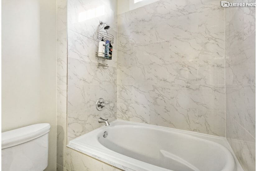Large marble tub and shower for bedrooms 1 and 2