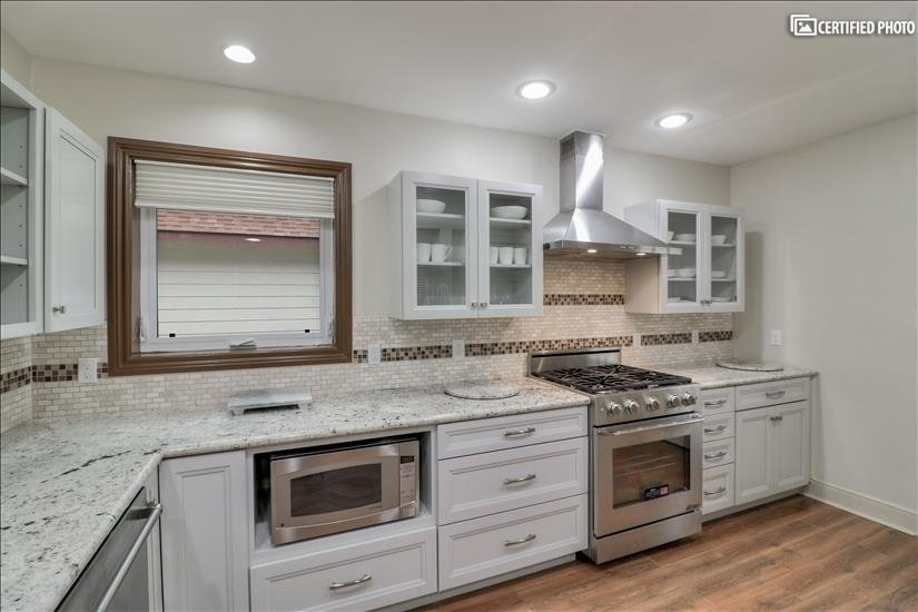 Kitchen - lots of natural light through the windows.