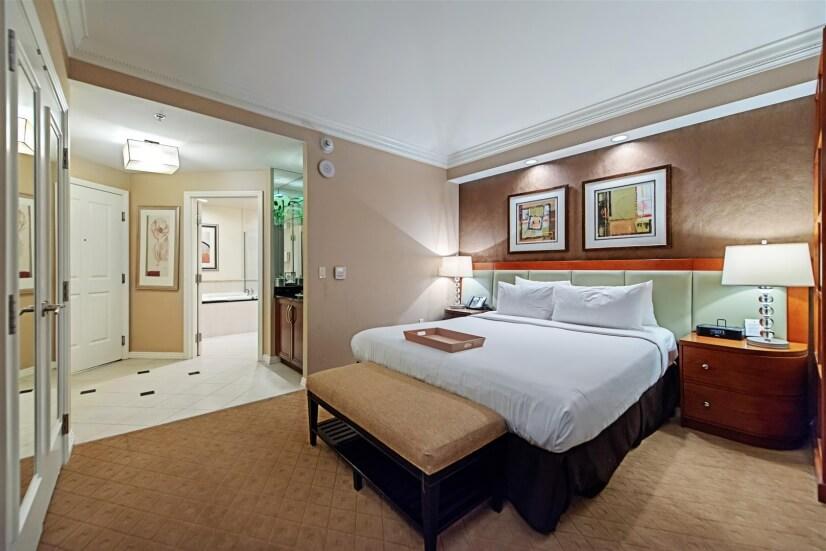 Bedroom area & bathroom in background