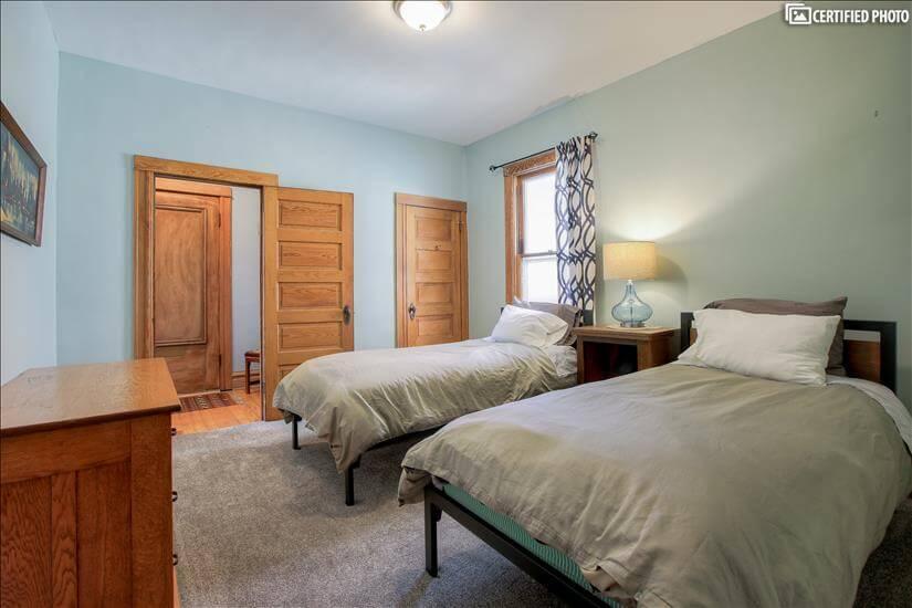 Oak dresser, closet for storage, door to entry