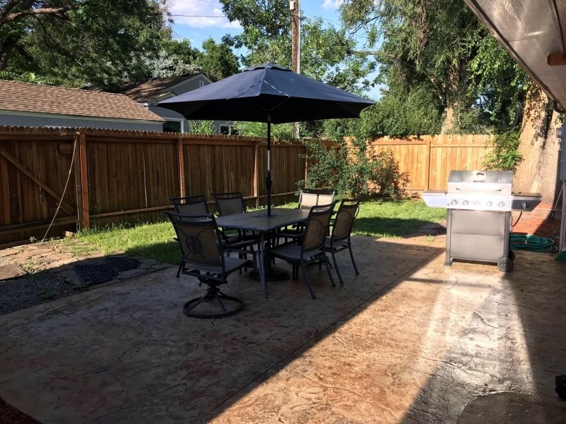 Fenced back yard, Patio table, grill, dog friendly