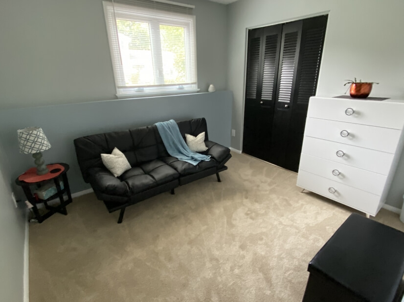 Lower level bedroom with a comfortable memory foam full size