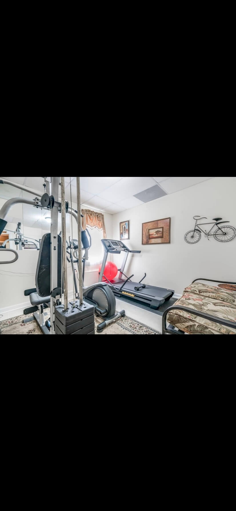 exercise area with Treadmill and weights