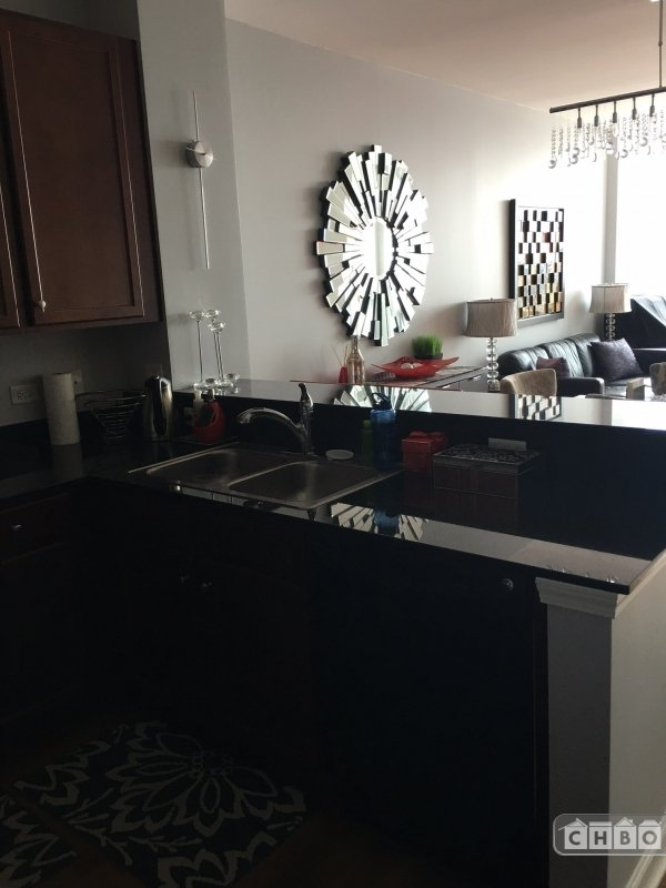Kitchen sink and counter overlooking dining and living space