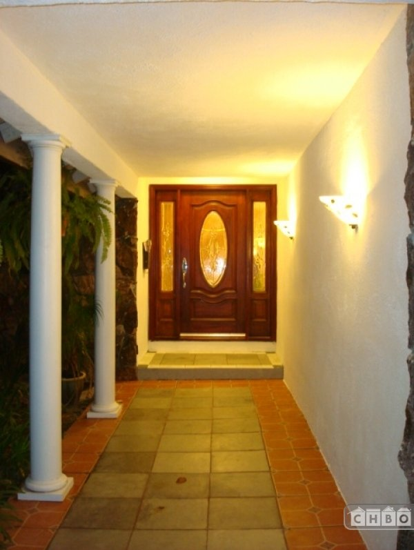 Grand Entry with Mahogany door and night lighting