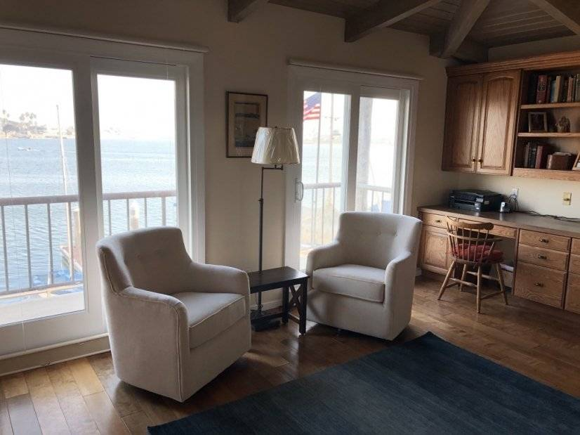 Master sitting area with bay view and built in desks