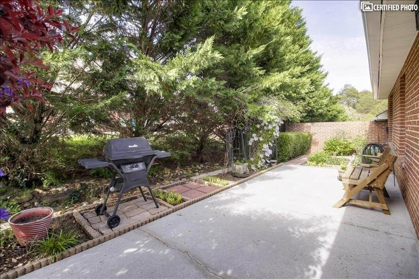 Private beautifully landscaped patio w/ gas g