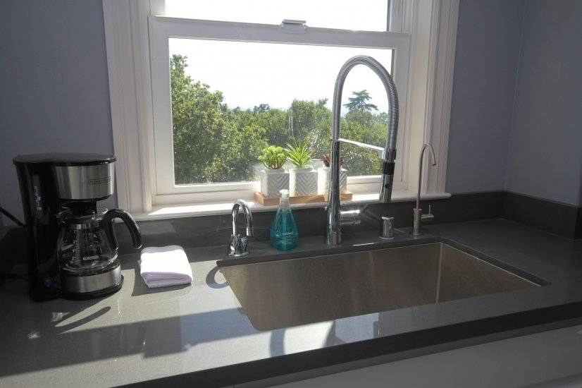 Kitchen sink with water filter and hot water dispenser