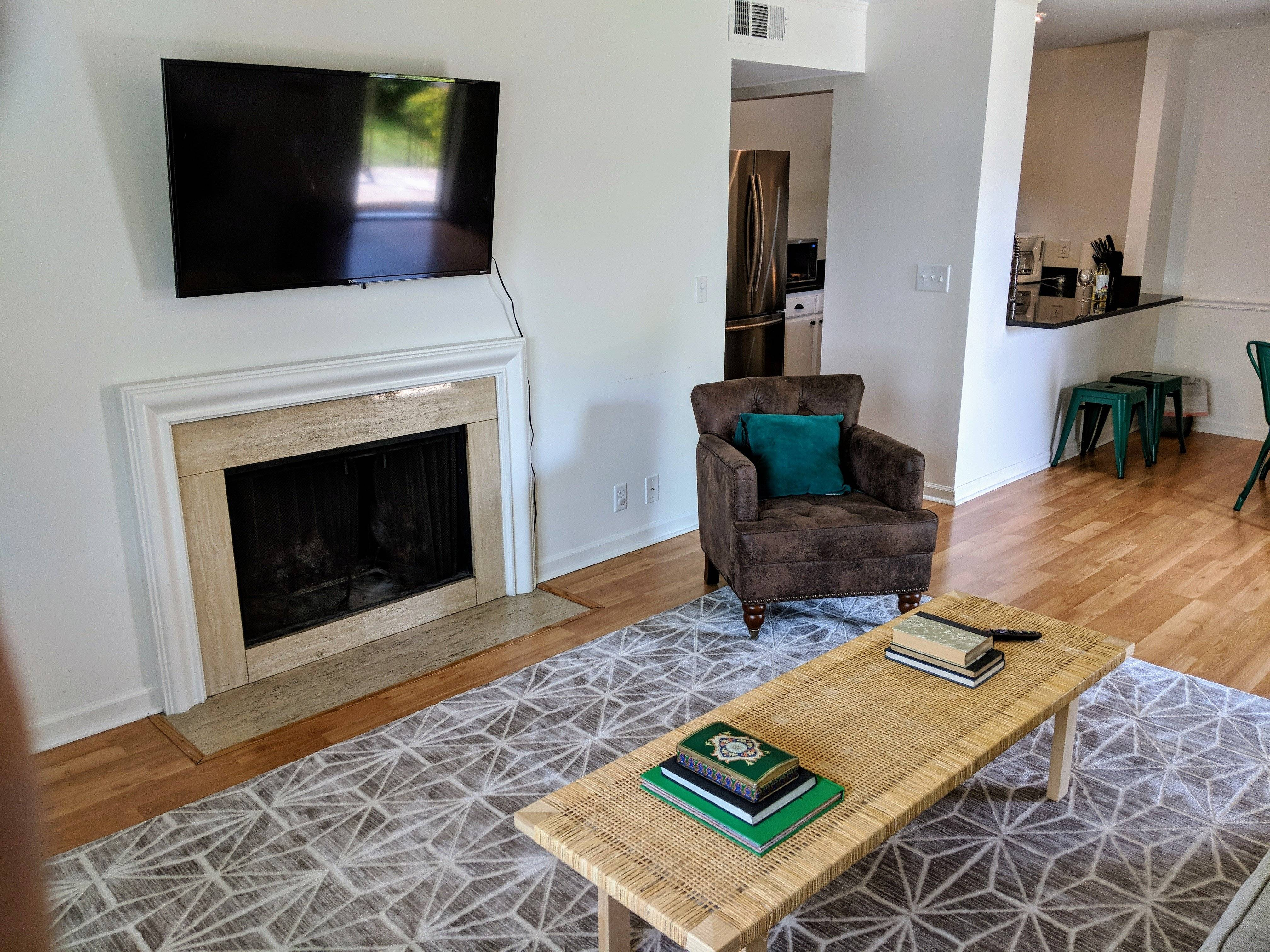 Open floorplan with fireplace and tv included