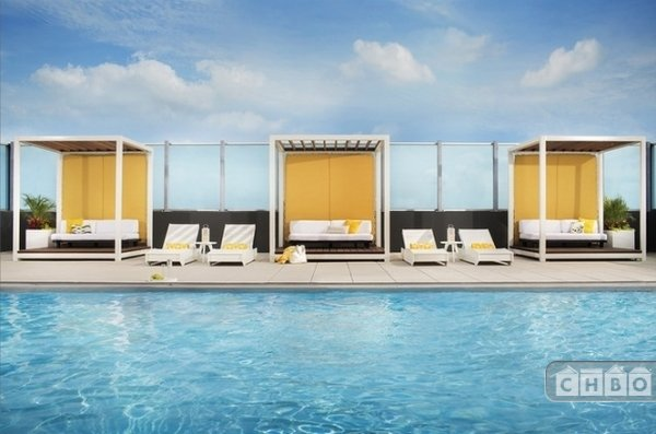 Rooftop pool with cabanas