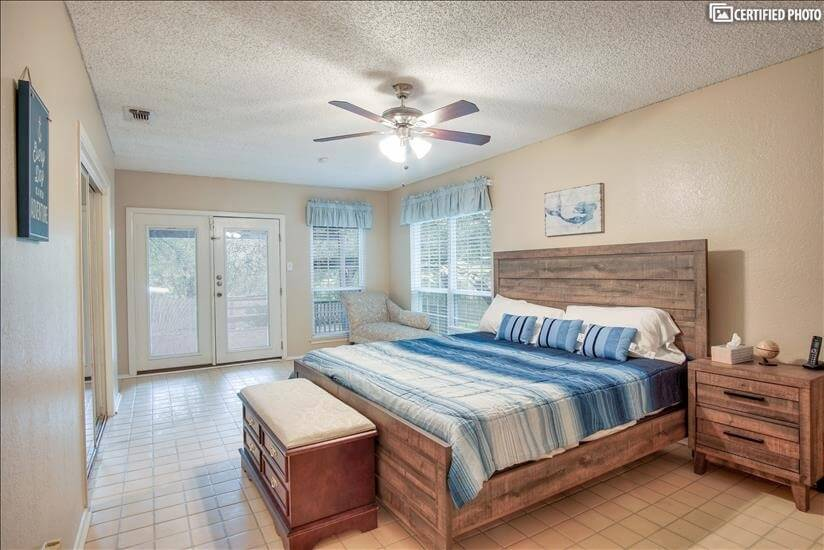 Master bedroom w/King Size bed, dresser & Sma
