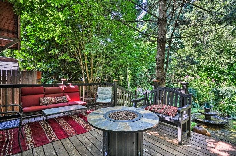 Back deck leads to garden and fountain