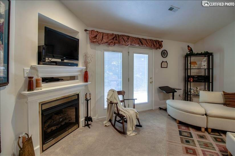 Decorative Fireplace & Access to Patio