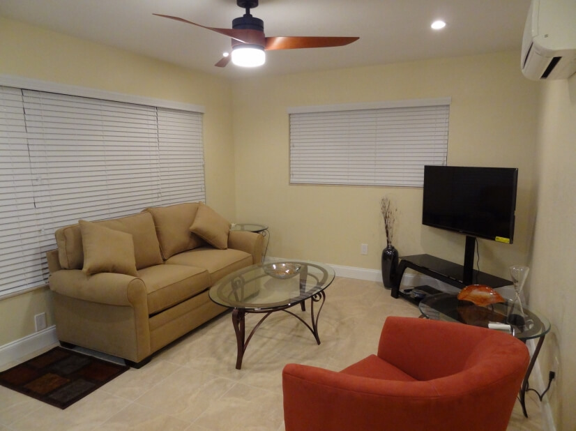 Spacious living room with contemporary furniture & 4K UHD TV