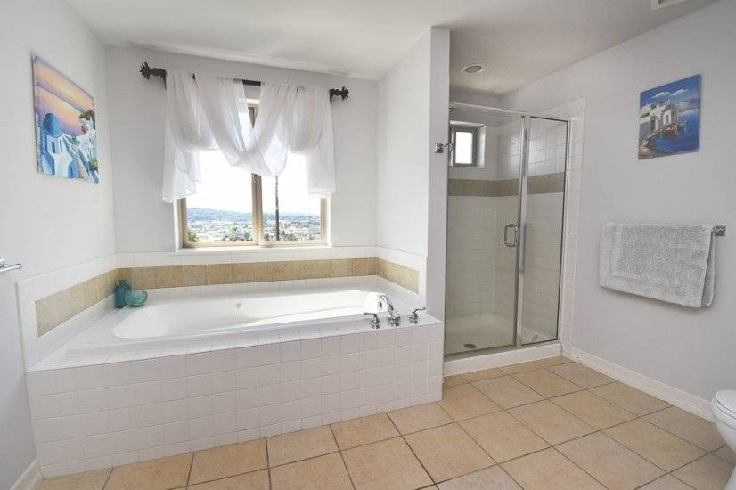 Master bathroom has jetted tub, and standing shower