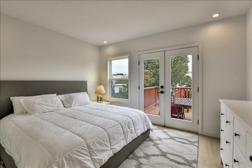 Master bedroom with French doors onto the deck