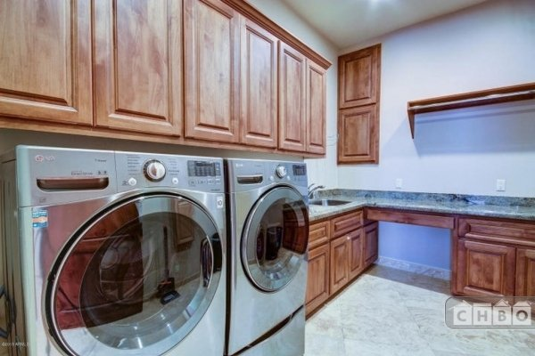 Laundry room with sink and plenty of counter space