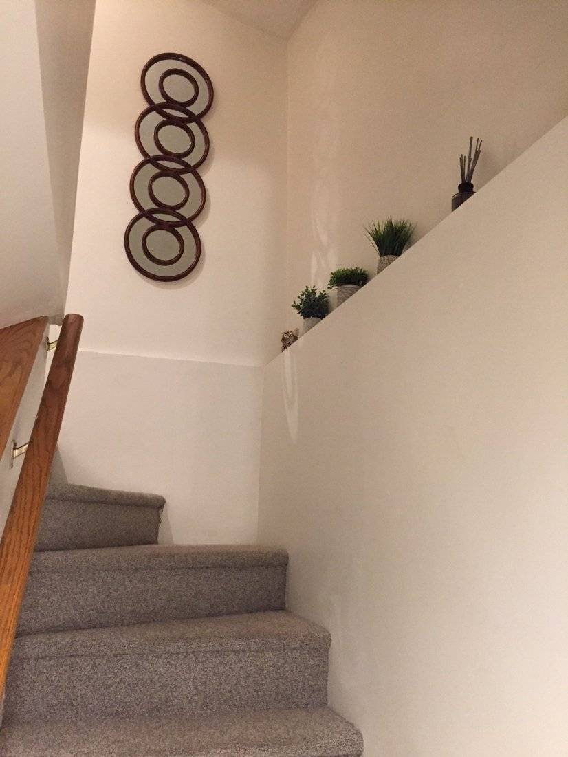Staircase to basement level and living room