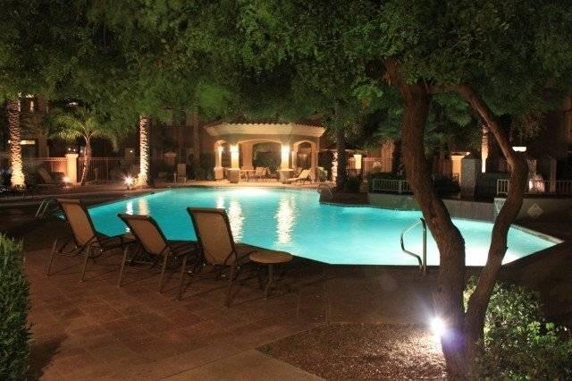 Beautiful pool area at night.