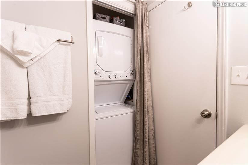 Brand new stacked washer and dryer