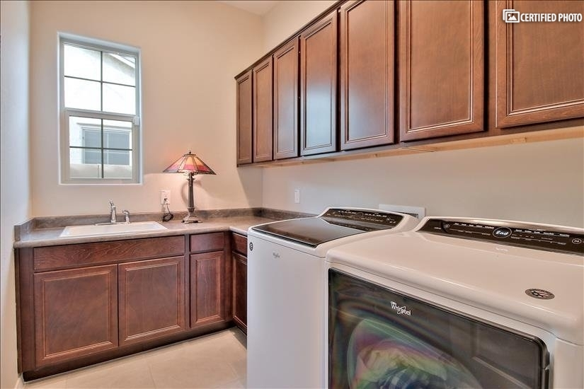 laundry room with upgrade large capacity washer and dryer.