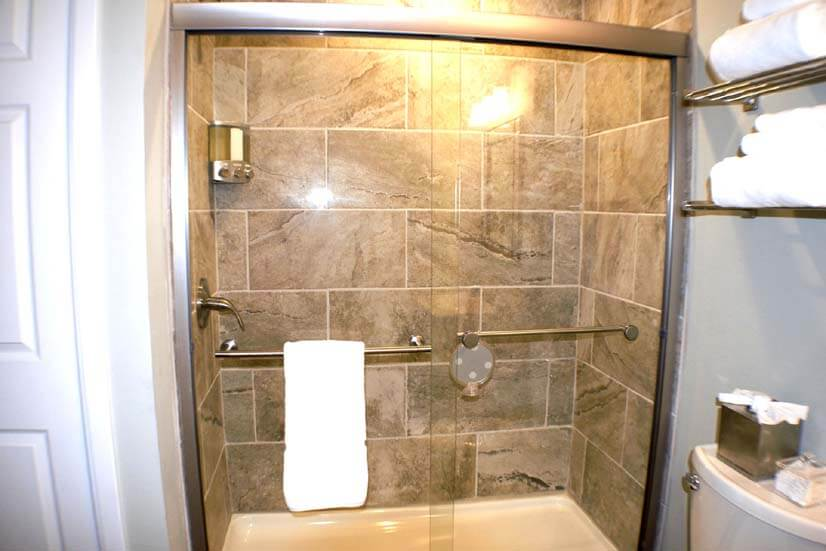 Large shower / front loading washer & dryer in closet