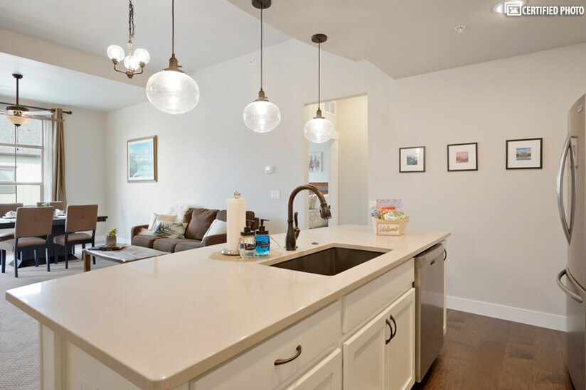 Huge Island with modern undermount sink and pull down faucet