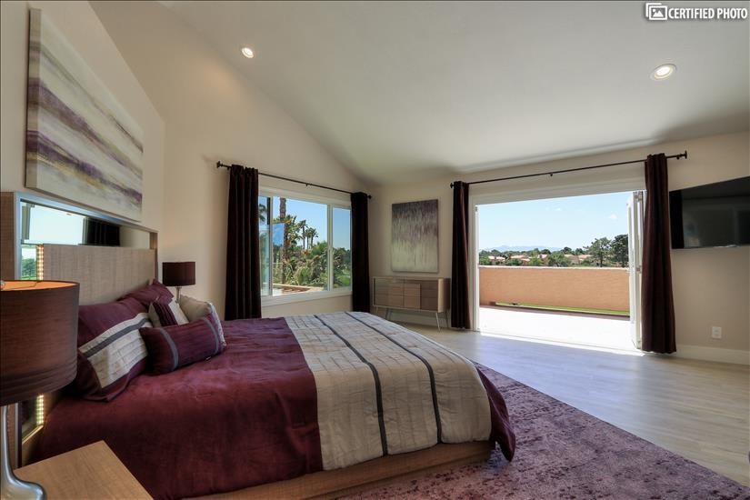 Master suite:custom folding doors w pool/golf course view!