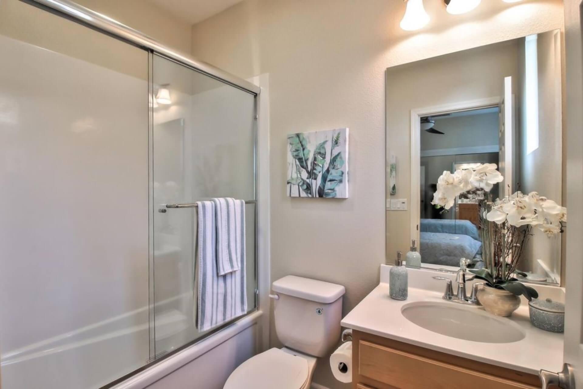 second bath with bath tub and shower head.
