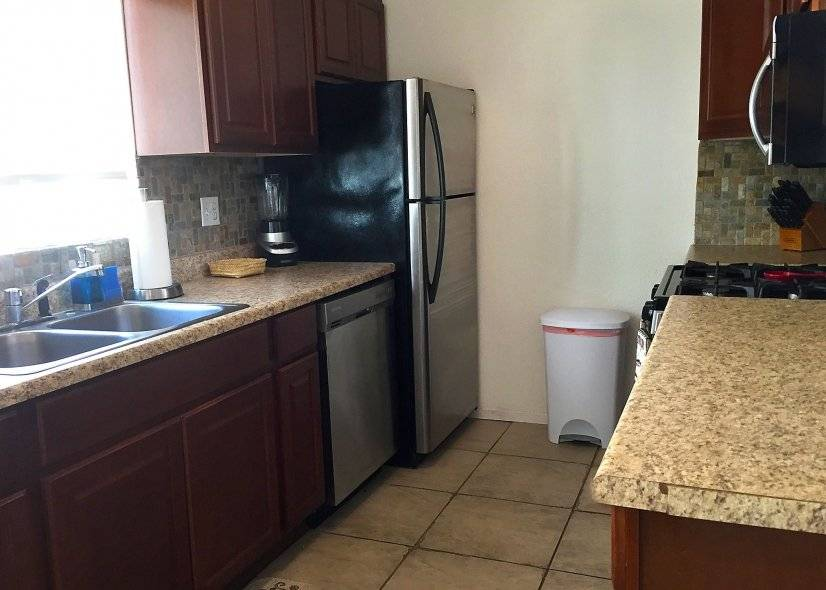 kitchen has natural light and modern appliances,