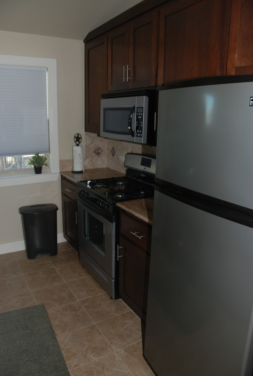 Kitchen fully equipped with gas stove, disposal, dishwasher.