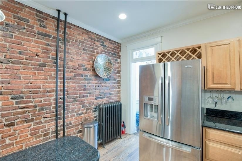 The exposed brick wall gives the room a charming feel