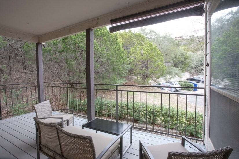 Wonderful patio furniture w/ view of the luxury homes above!