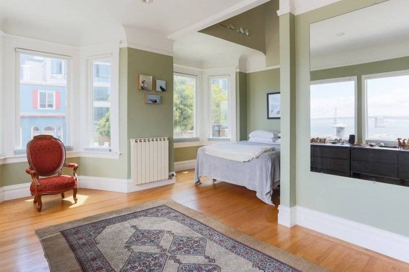Master bedroom w/abundant space & 360-degree natural light