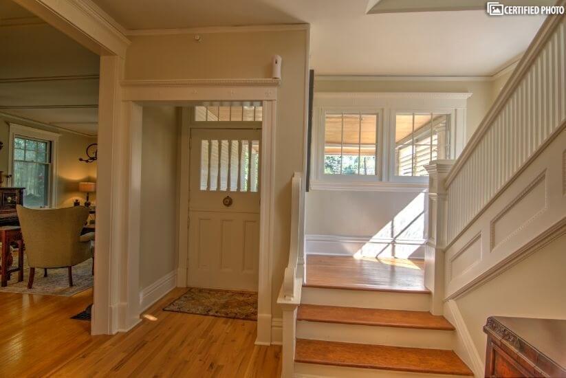 Main hallway with antique wood door