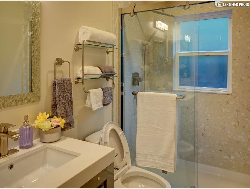 Studio C - Full size bathroom with new GOSHE shower system.