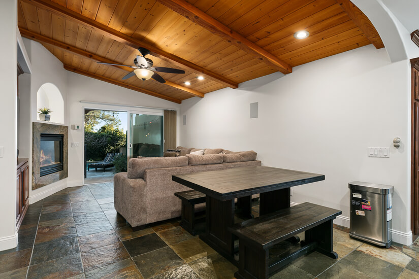 Quaint back living area with enormous couch