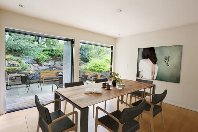 Spacious dining area with a wide plank table