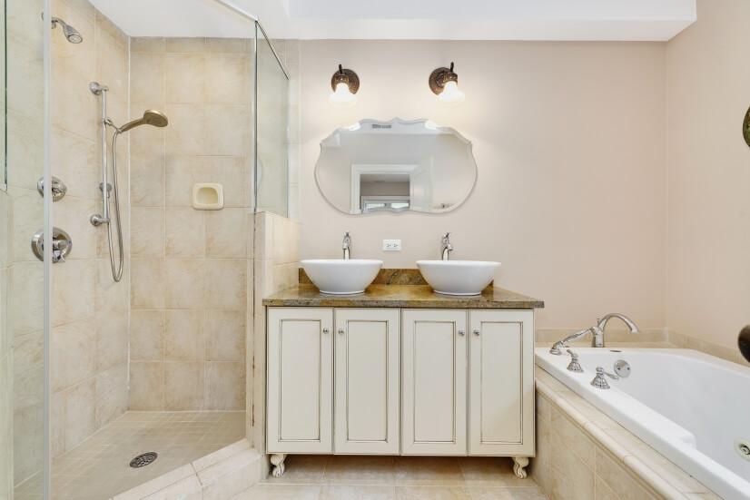Master bath with whirlpool tub.