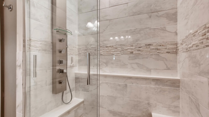 Guest bath shower with shower panel and body jets