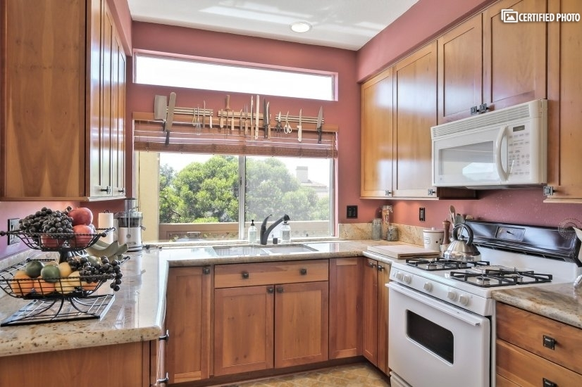 Granite counters, cherry wood cabinets