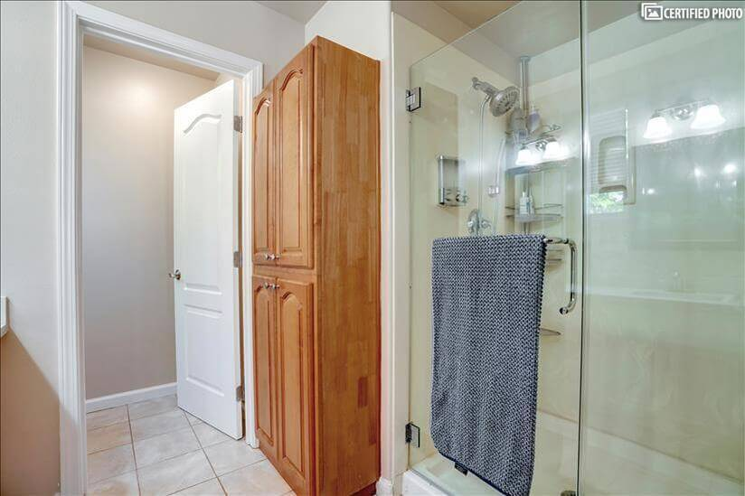 upgraded master bathroom with storage cabinet