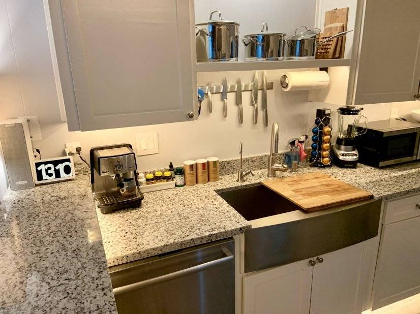 Kitchen with dishwasher. Google Home system.