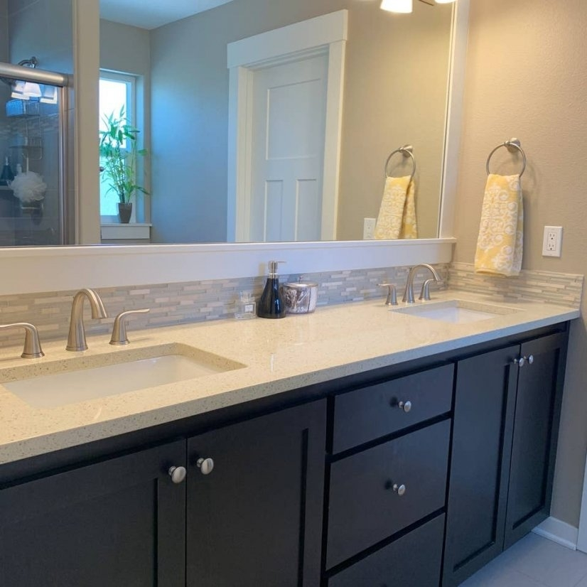Master Bathroom with two sinks, shower and walk-in closet