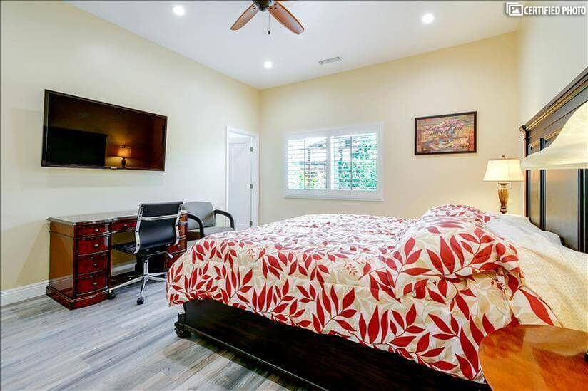 50 inch TV and work desk in master bedroom 1