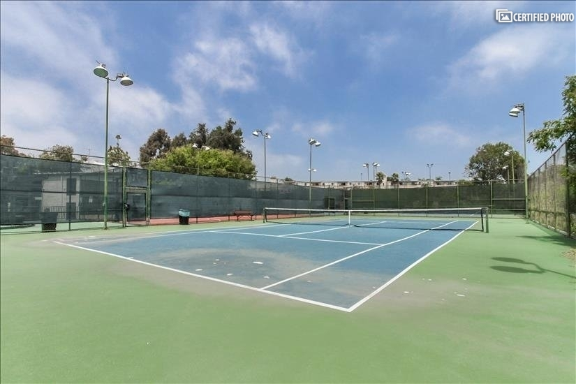 A full-sized tennis court.